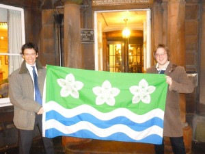 Photograph of Rory Stewart MP and Philip Tibbetts with the Cumberland Flag - Credit: Gethin Jenkins (Office of Rory Stewart MP)