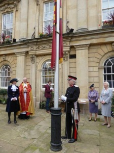 Lord Lieutenant David Laing hoists the Northamptonshire flag at its unveiling.